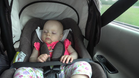 Baby Girl Sleeping in Child Car Seat Footage