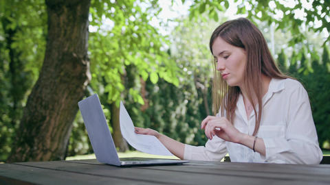 Business Lady Using a Laptop in the Park Footage