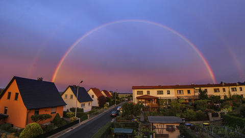 Rainbow Timelapse Over Small Town At Sunset Bild