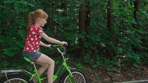 Little girl riding a bicycle Footage