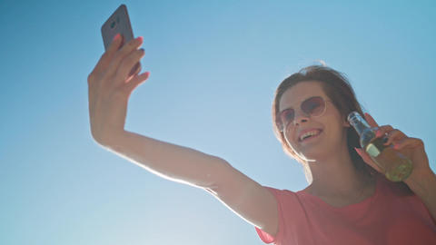A Young Lady Making a Selfie on the Beach Image