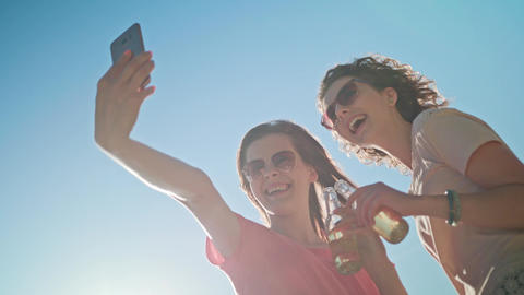 Two Young Ladies Making a Selfie on the Beach Footage