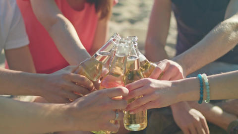 Young People Clinking Bottles on the Beach Footage