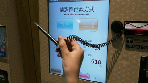 Young girl using Japanese style Automated machine to order food pays and Image