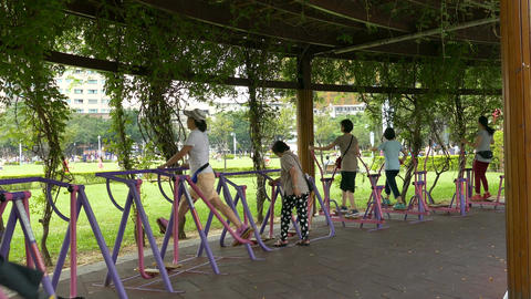 People exercising at park Image