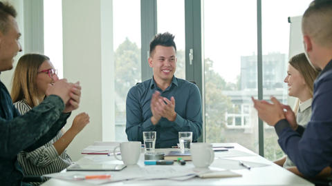 High Fives Members at a Startup in a Modern Office GIF