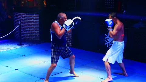 Two Adult Men Fight in Thai Box Competition Inside Nightclub Footage