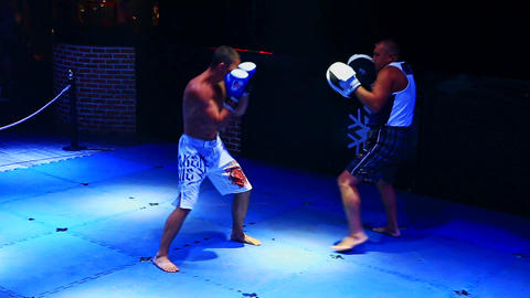 Two Adult Men Fight in Thai Box Competition Inside Nightclub Stock Video Footage