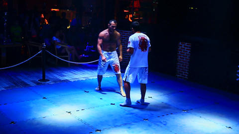 Boxers Fight Barefoot Demonstrate Strength in Night Club Live Action