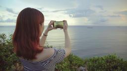 girl taking photo on the beach. Handheld shot Live影片