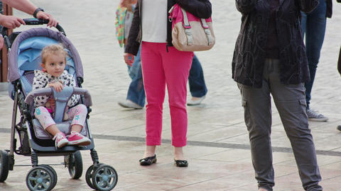 Family Walks the Street With Daughter in Stroller Footage