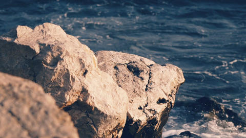 Slowmotion of ocean waves beating against the stone beach Footage