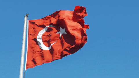 Slowmotion of Turkish flag waving in blue sky outdoors Footage