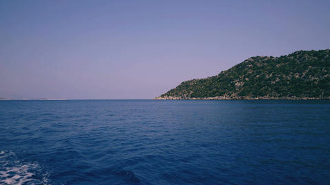Mediterranean sea landscape view of coast and mountains from floating ship Footage