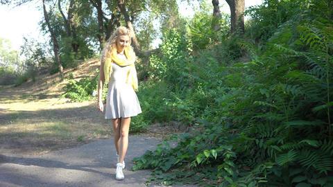4K Glamorous Woman Walking Through A Park Footage