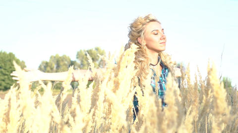 Slow Motion Girl With Arms Outstretched In A Wheat Field Footage