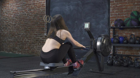 woman doing rowing machine workout Live Action