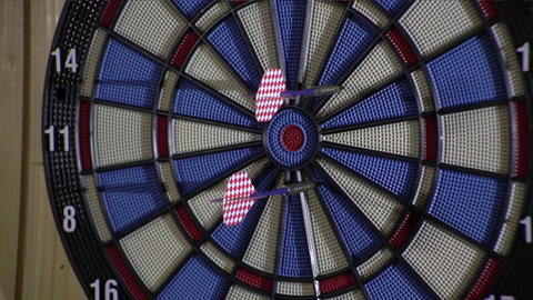 Competitors throw at target with blue and pink arrows 98 Live Action