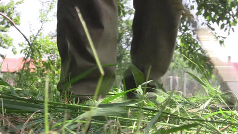 Farmer cut green grass and high with a trimmer on benzine 1a Footage