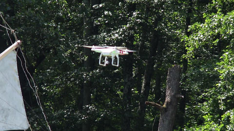 Drone on the camcorder flying in the forest besides some wind mills 32 Footage