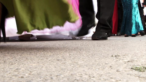 Feet of men and women are in a procession wedding on a small country town street Footage