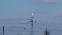 Slow motion zoom out close up extremely long wind turbine power lines poles Footage