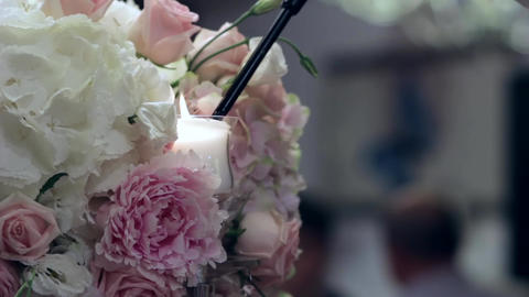 Man kindle candles with a long lighter, located in beautiful bouquet of roses si Footage