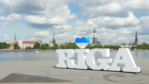 Riga sign, majestic clouds, city view, timelapse, zoom in, 4k Footage