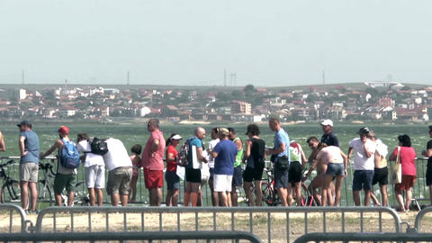 People sitting on the seashore and watch a sporting event in progress 15 Footage