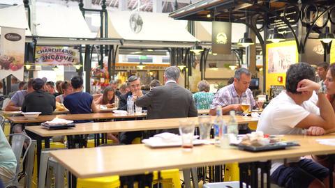 Tourists Having Lunch At Lisbon Market Restaurant Live Action
