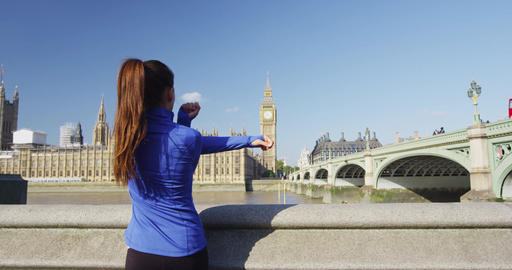 London lifestyle woman running and stretching near Westminster Bridge London Footage