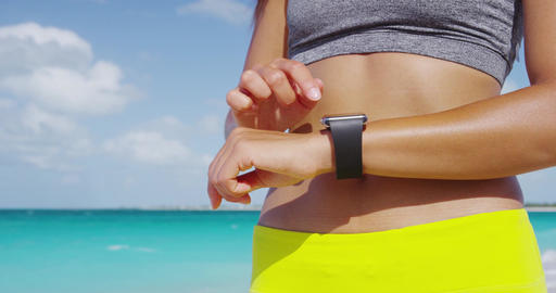 Fitness woman runner woman wearing smartwatch touching and swiping screen Footage