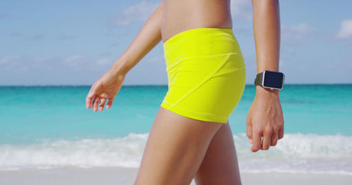 Smartwatch - Fitness woman wearing smart watch on beach Footage