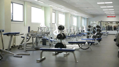 Camera Shows Spacious Light Empty Gym with Trainers Footage