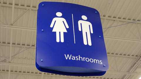 Motion of man and woman washroom logo hanging up the roof with 4k resolution Live Action