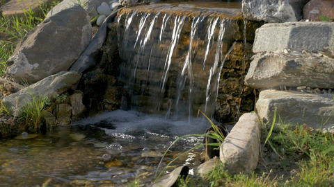 A small decorative waterfall with stones Footage