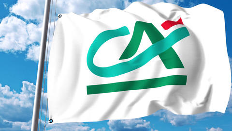 Waving flag with Credit Agricole logo against clouds and sky. 4K editorial Footage