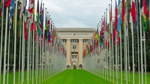 United Nations building with flags, Geneva, Switzerland, zoom in, 4K Footage
