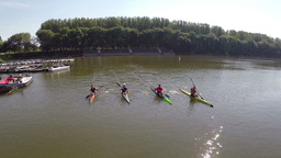 Four young man rowing their kayaks Footage