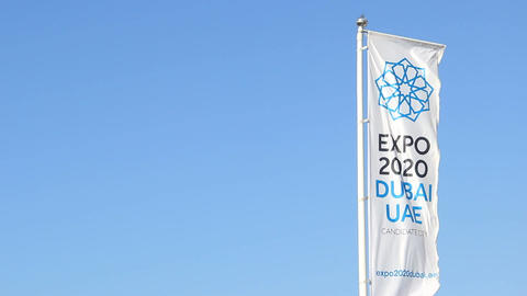 World Expo 2020 in Dubai, vertical banner flag flutter on wind against blue sky Footage