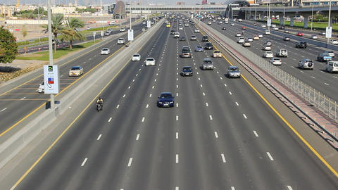 Sparse traffic at daytime, Sheikh Zayed road perspective, wide angle Footage