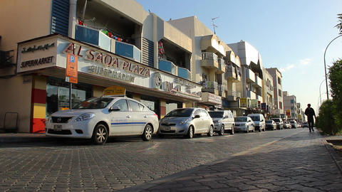 Side Road At Satwa District Of Dubai At Sunny Evening, Low Angle Shot stock footage