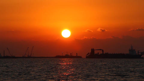 Vibrant sunset color over Arabian Gulf, artificial island development area Footage