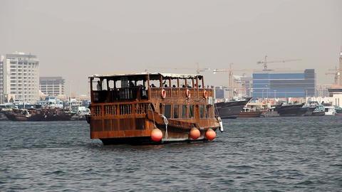 Double decker floating restaurant, cruise dhow boat sail away along Dubai Creek Footage