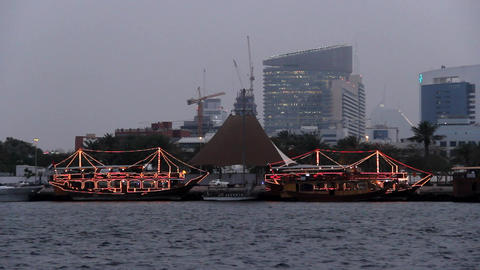 Dinner cruise dhow boats, floating restaurants decorated by glow garland Footage