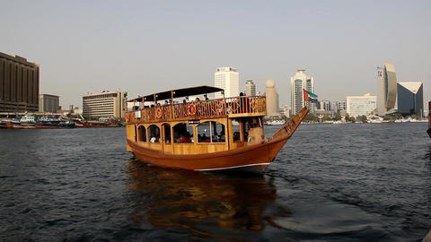 Wood dhow restaurant boat recede from shore, close view of departing vessel Footage