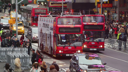 Buses And People On The Street Of NYC stock footage