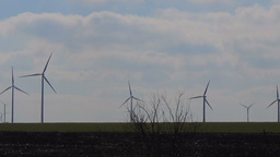 Slow motion seamless loop wind park farm renewable eco green energy blue sky Footage