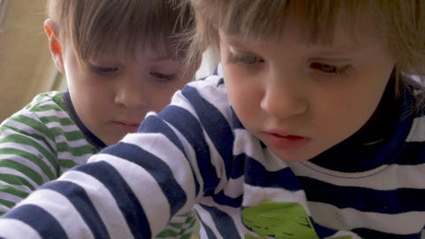 Adorable young boy and girl siblings playing, focusing and concentrating Footage