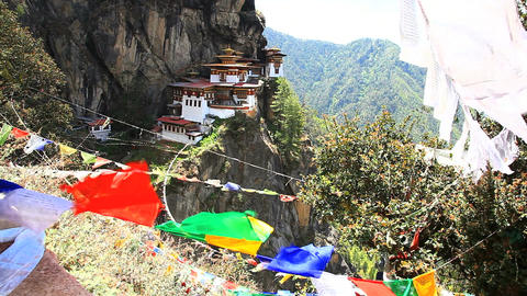 View of Taktshang monastery with prayer flags in Paro ビデオ